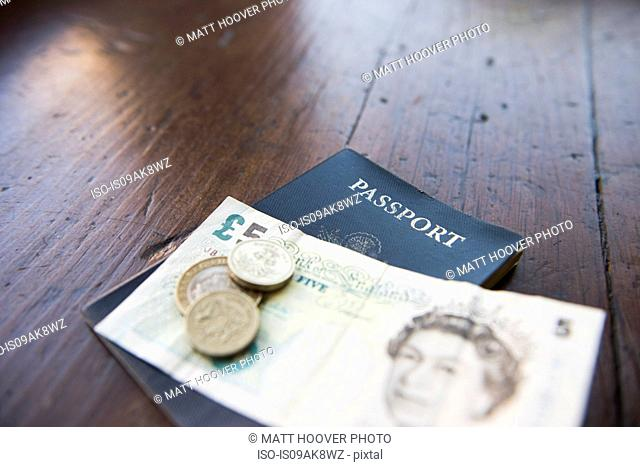 British banknote, coins and passport