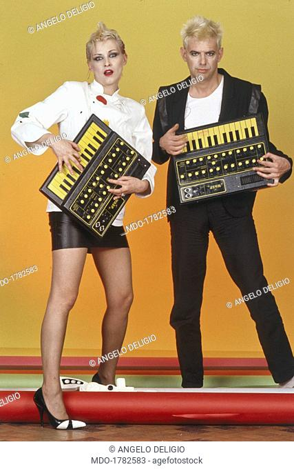 Italian singer-songwriter and composer Maurizio Arcieri and Swiss singer Christina Moser, members of the band Krisma playing keyboards. 1980