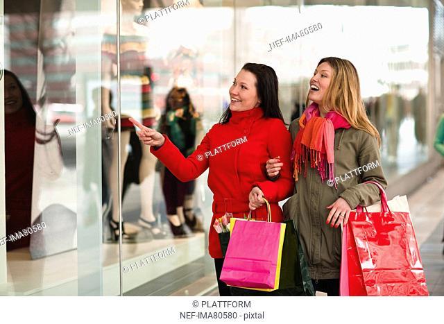 Pair of young women window shopping