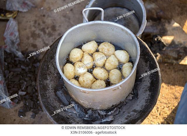 Potatoes (Solanum tuberosum) boil in a large pot in Ganta, Liberia