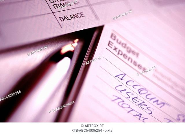 Close-up of a financial document with a ballpoint pen