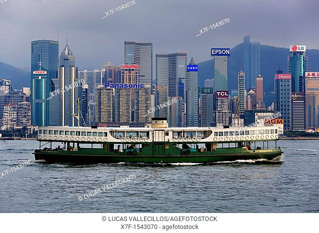 Star Ferry running in Victoria Harbour with City Skyline in the Background,Hong Kong, China