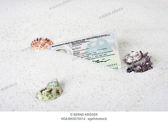 Identity card in the sand
