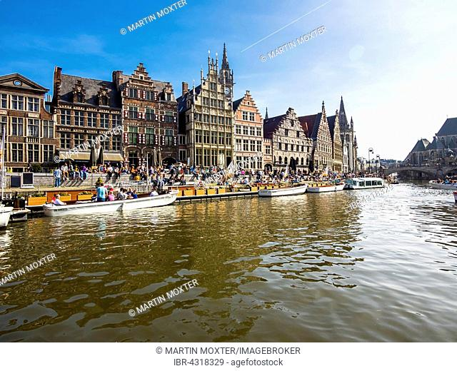 Leie River and promenade on the Graslei, with old guild houses and pleasure boats, Ghent, Flanders, Belgium