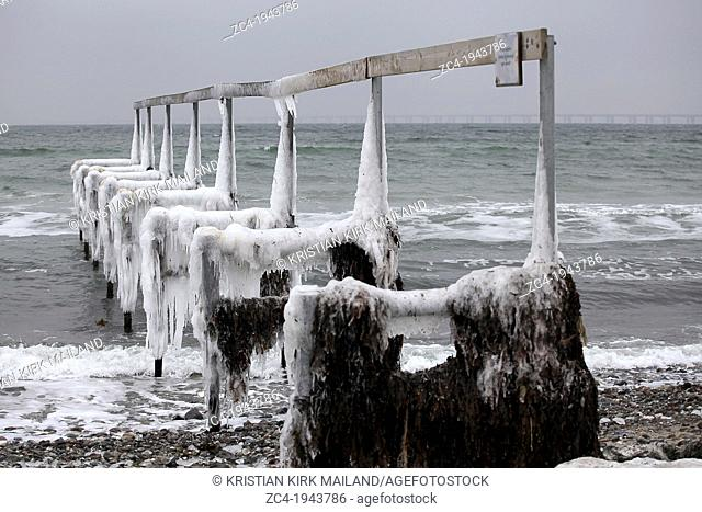 Svim jetty at winter season. Cold and covered with ice. Scandinavia