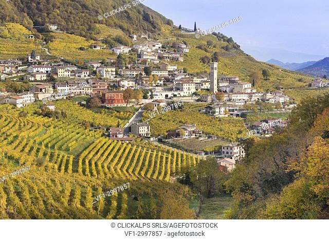 the village of Santo Stefano surrounded by the yellow vineyards in autumn, along the road of wine, Valdobbiadene, Treviso, Veneto, Italy