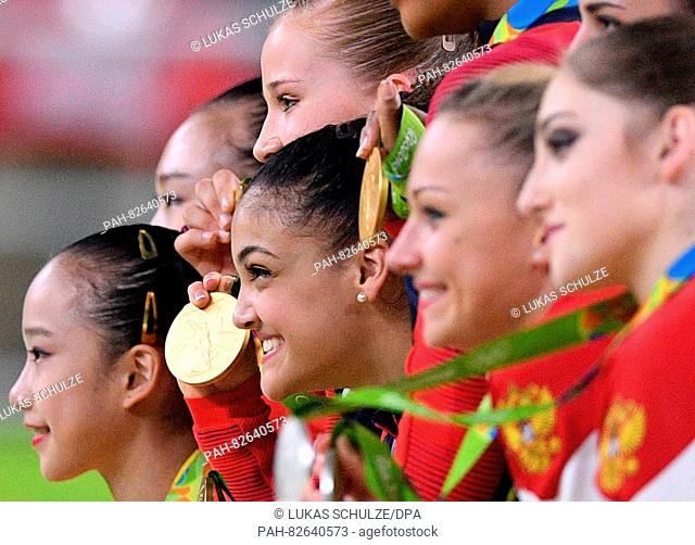 Lauren Hernandez (C) of the USA displays her Gold medal as she takes part in the medal ceremony with other medalists after the Artistic Gymnastics Women's Team...