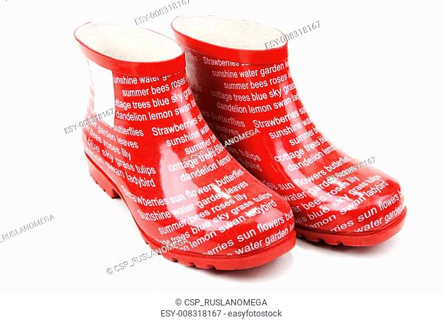 Red rubber boots with inscription