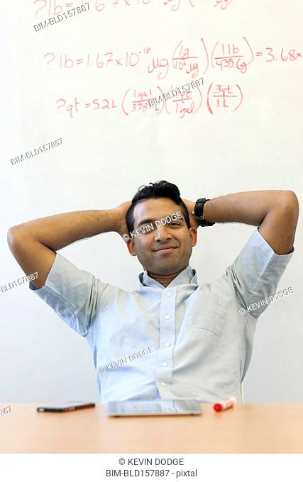 Asian businessman relaxing at desk