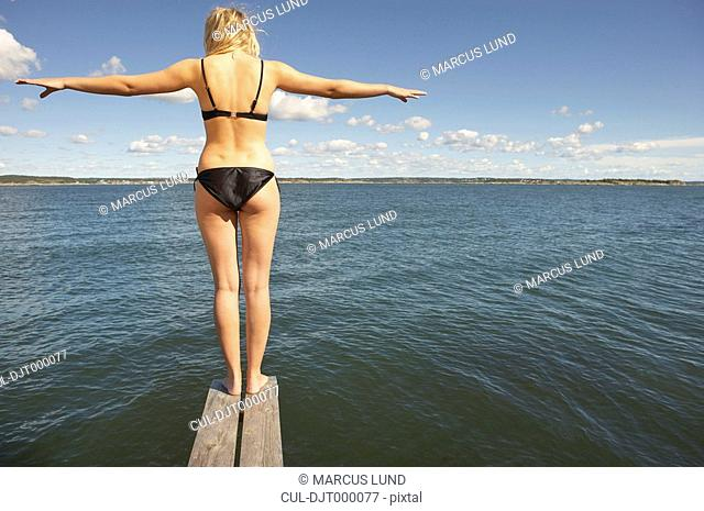 Young woman on diving platform