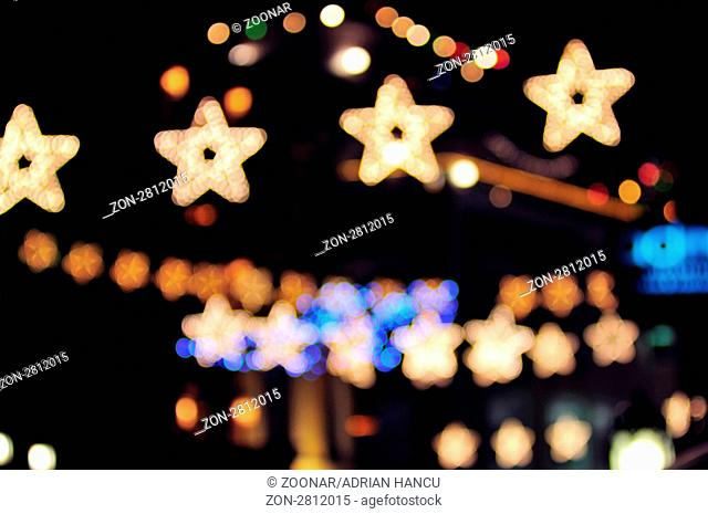 This photograph represent a beautiful abstract holiday lights in a city. Image is blurry