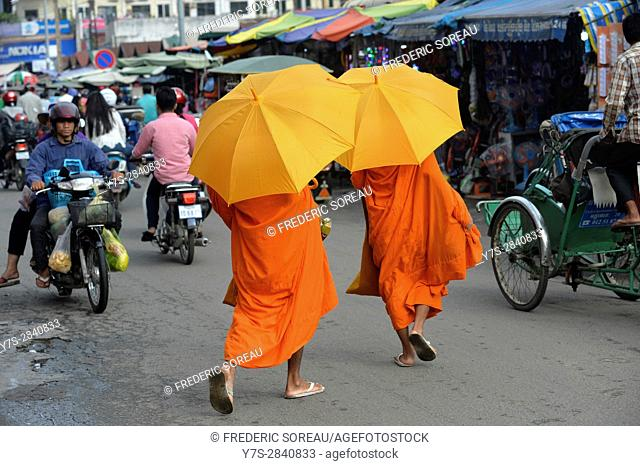 Buddhist monks receiving early morning food alms in Phnom Penh,Cambodia,Indochina,Southeast Asia,Asia