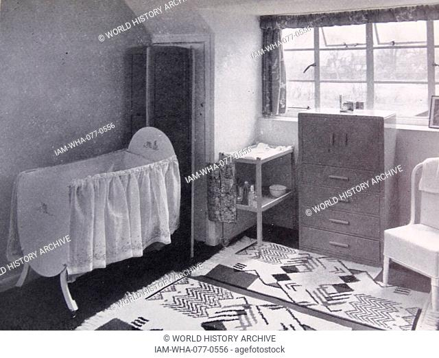 Photograph of a modern nursery, in a small town house, with washable rugs to cover the linoleum-covered floor