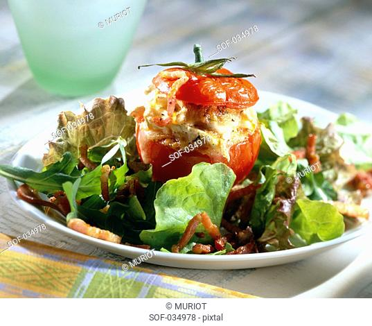 Tomato stuffed with chaource and bacon