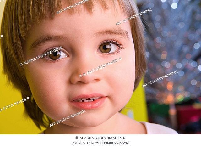 Closeup portrait of young girl smiling winter Alaska