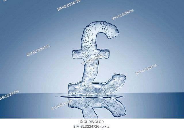 Puddle under melting ice British pound symbol