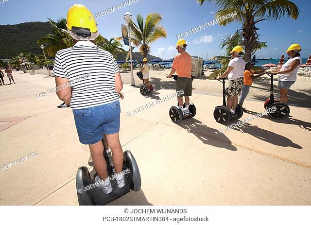 Sint Maarten, Philipsburg, cruise ship passengers on a Segway excursion on the boardwalk
