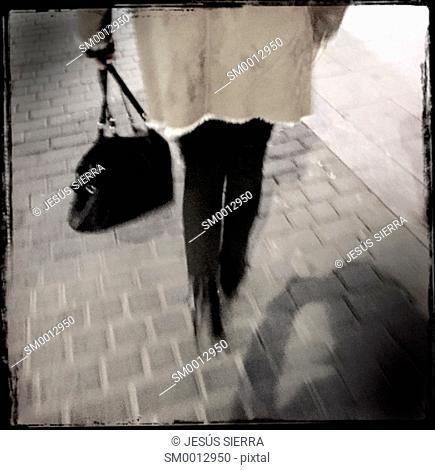 Girl walking in Malasaña, Madrid