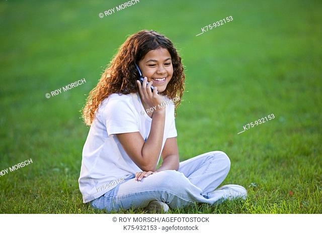 Teen talking on cell phone outdoors