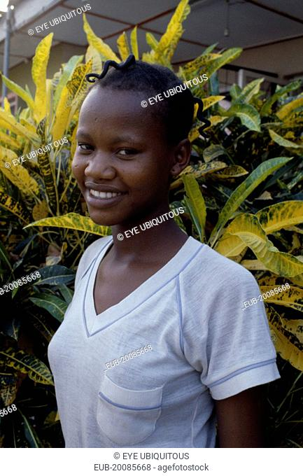 Three-quarter portrait of smiling young Ibo girl