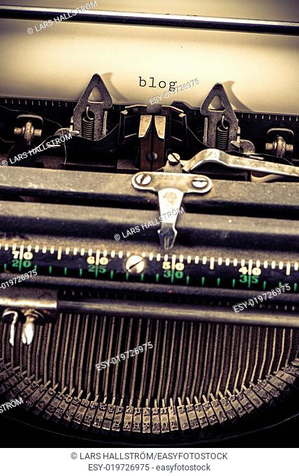 Retro vintage typewriter and the text blog. Conceptual image of old fashioned office work, communication or writing