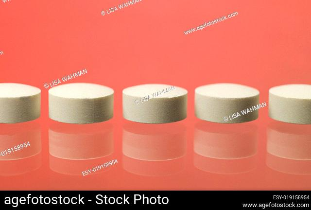 Pills toward red background