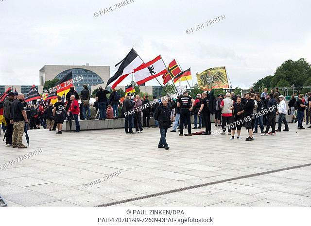 Participants of a right-wing demonstration walk past the German government district in Berlin, Germany, 1 July 2017. According to police sources some 200 people...