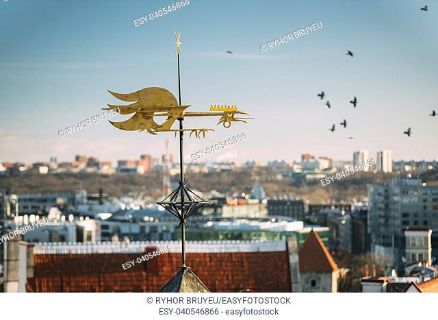 Tallinn, Estonia, Europe. Close Up Of Cock-rope Weather Vane On Roof Of Old Medieval House In Winter Sunny Morning