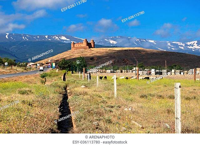View of the castle (Castillo de La Calahorra) with the snow capped mountains of the Sierra Nevada to the rear, La Calahorra, Granada Province, Andalusia, Spain