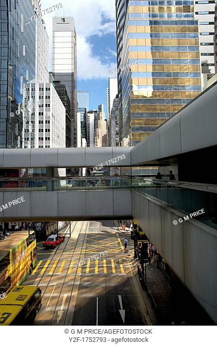 elevated view of intersection in downtown Central district, Hong Kong, with buses and taxi