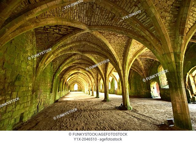Gothic arches of the great hall of Fountains Abbey , founded in 1132, is one of the largest and best preserved ruined Cistercian monasteries in England