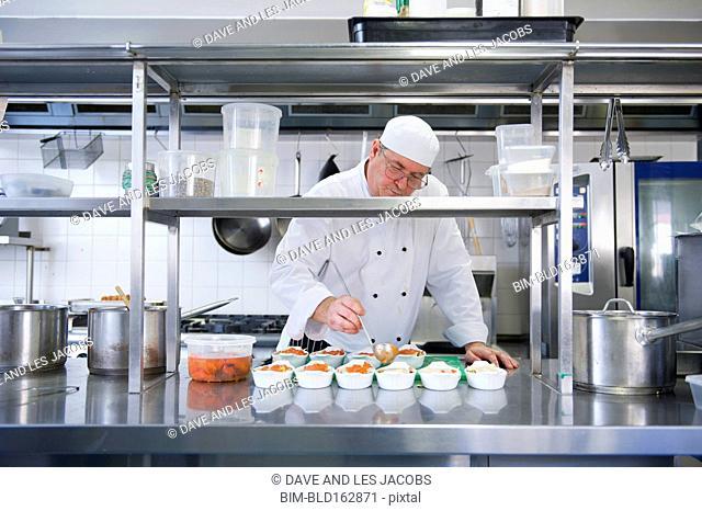 Caucasian chef cooking in restaurant kitchen