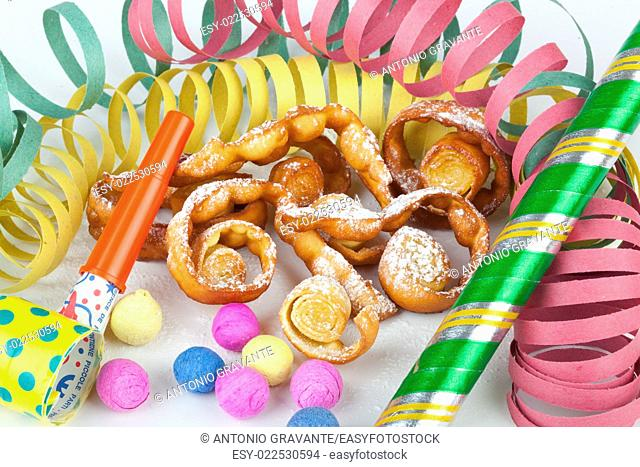 """Typical Italian dessert for carnival, """"""""chiacchiere"""""""" fries with toys and confetti"""