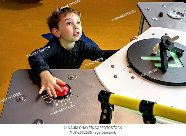 Thrilled boy manages simulator, Please Touch Museum, Philadelphia, PA, USA, North America