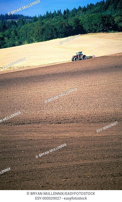 Tractor plowing field. Willamette Valley. Oregon. USA