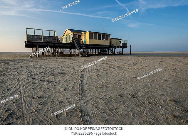 Schiermonnikoog, Netherlands. Beach house on wooden poles on the UNESCO Wadden Island Schiermonnikoog's most northern beach, bordering the North Sea