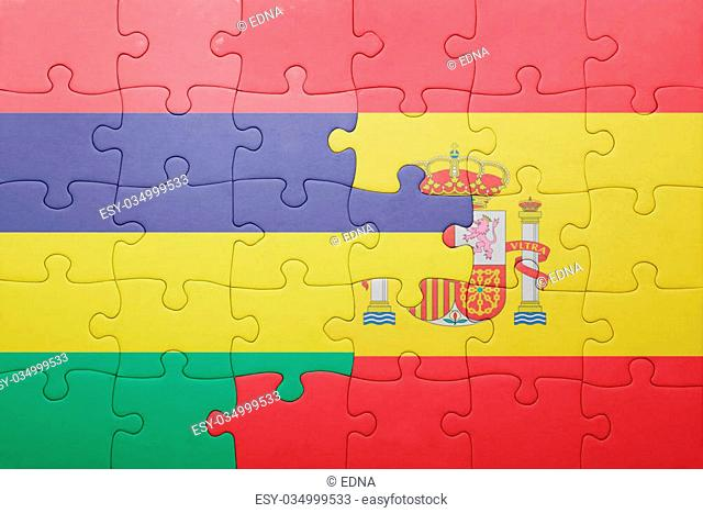 puzzle with the national flag of spain and mauritius . concept