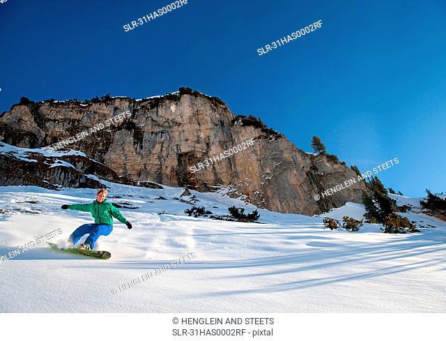 Snowboarder free riding