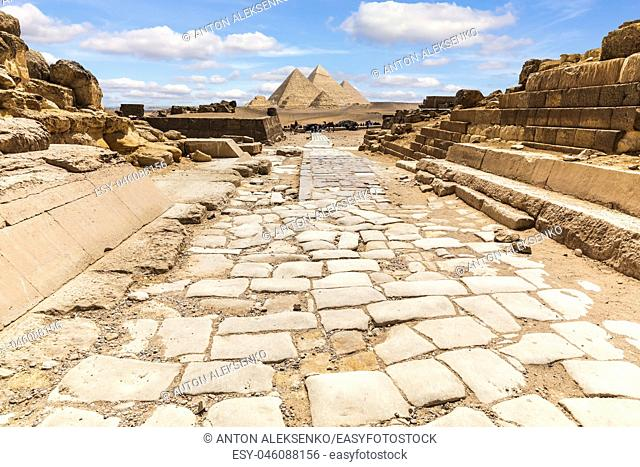Giza Temple ruins and the road to the Great Pyramids, Egypt