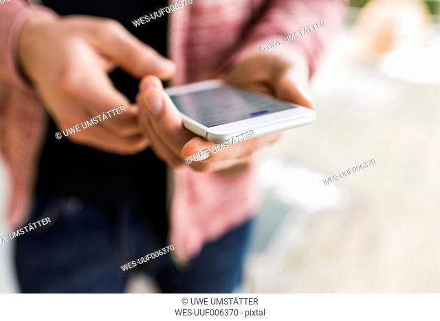 Close-up of man holding smarthone