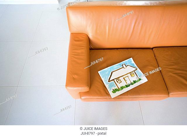 Painting of house on sofa, elevated view