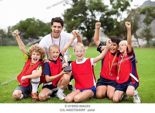 Children cheering with coach