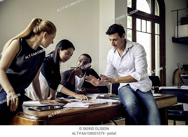 Colleagues brainstorming in casual office