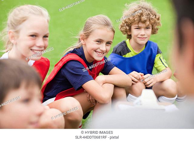 Children laughing during soccer practice
