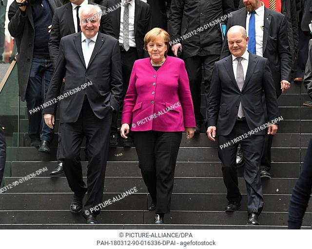 12 March 2018, Germany, Berlin: German Chancellor Angela Merkel of the Christian Democratic Union (CDU), chairman of the Christian Social Union (CSU) Horst...