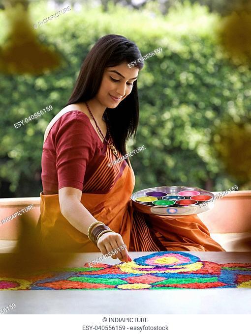 Woman making a rangoli