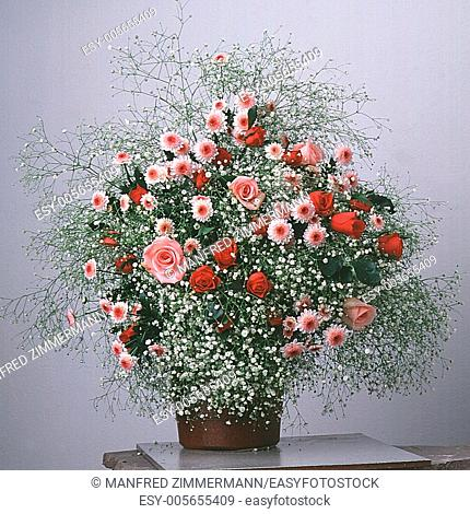 white / red flowers bouquet in vase