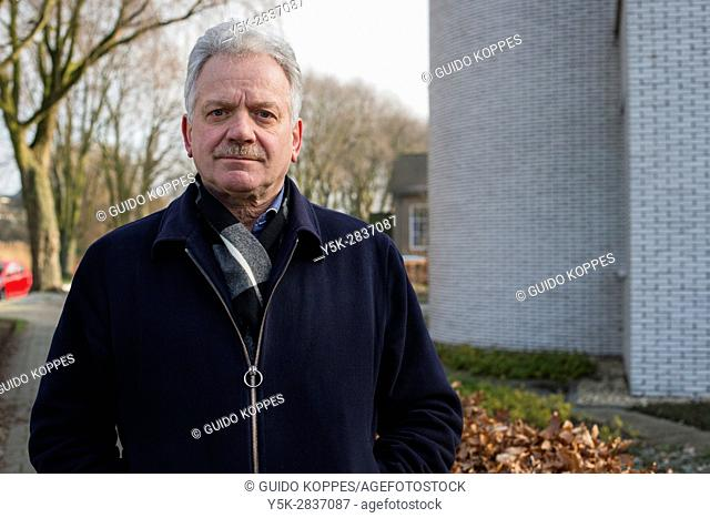 Zoetermeer, Netherlands. Portrait of a mature adult, caucasian male taking a stroll through his village's centre