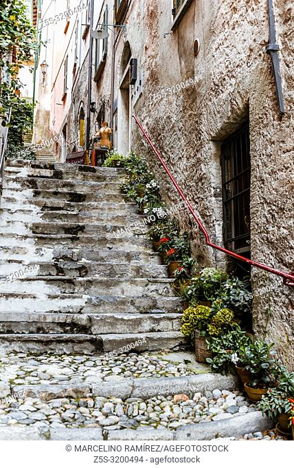 The narrow and steep street of the village. Varenna, Province of Lecco, Lombardy, Italy, Europe