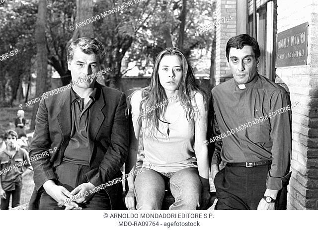 Italian actors Flavio Bucci, Michele Placido and Barbara De Rossi on the set of TV show La piovra. 14th September 1983